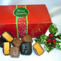 Festive Holiday box of gourmet Sponge Candy tied with green ribbon