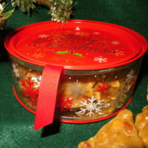 Festive Holiday canister filled with gourmet Peanut Brittle