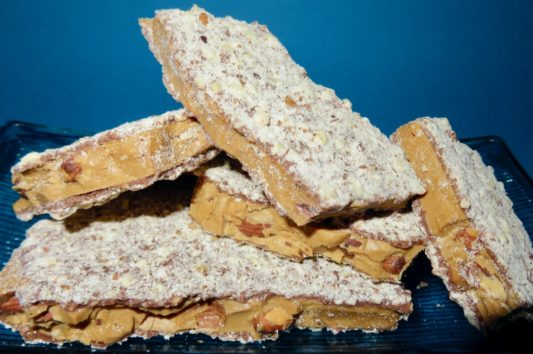dish of gourmet almond butter toffee