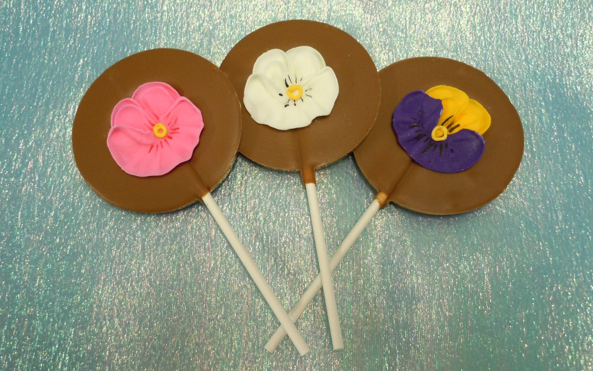 Bouquet of chocolate lollipops decorated with pansies