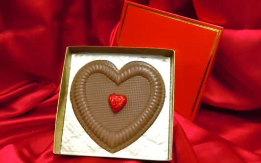 Beautiful solid milk chocolate heart in gold foiled gift box