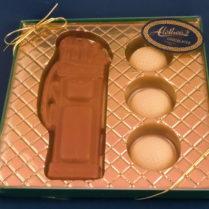 set of milk chocolate golf bag with ivory choc golf balls