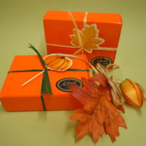 Orange gift box filled with mini chocolate turkeys