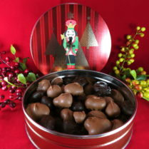 Holiday tin filled with gourmet assortment of chocolate covered nuts