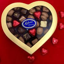 Gold heart holds gourmet chocolates