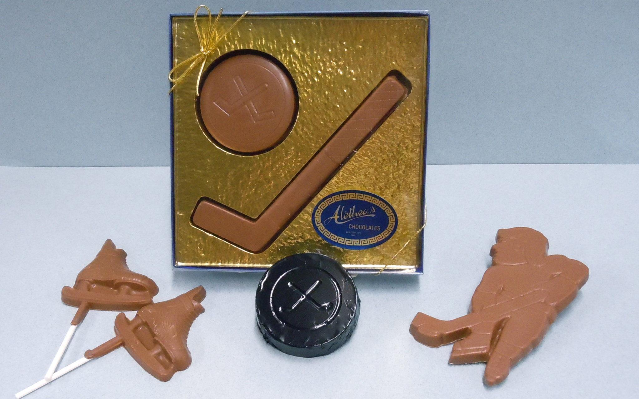 Chocolate Hockey stick, pucks, player