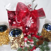Beautiful decorated Holiday gift bag filled with a variety of gourmet popsorns