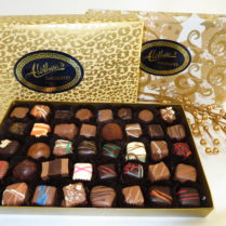 Holiday wrapped gourmet boxed chocolates