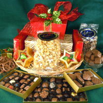 Beautiful chocolate gift tower on a round wicker tray