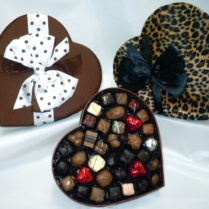 Lovely cocoa colored heartboxes filled withgourme chocolates