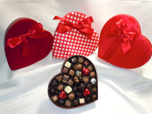 Assortment of Beautiful red Valentine heart boxes filled with gourmet chocolates