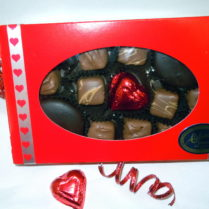 red valentine gift box filled withchocolate peanut butter confections