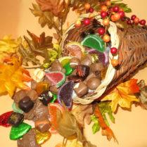 Beautiful cornucopia basket witha bounty of gourmet chocolate confections.