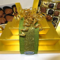 Glittery gold tower of gourmet chocoate confecions