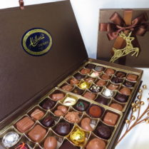 elegant Book style box filled with gourmet chocolates