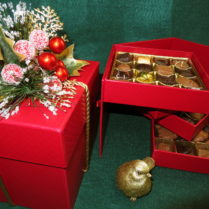 Beautiful jewelry style tiered box filled with gourmet chocolate confections