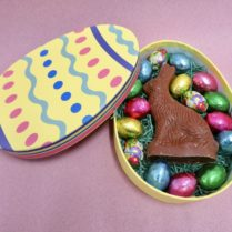 Charming Chocolate Easter Bunny with chocolate eggs in an egg shaped box