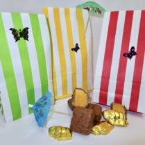 Cabana stripe gift bags hold gourmet sponge candy and chocolate buffalo