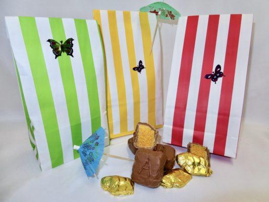 Cabana stripe gift bags hold gourmet sponge candy and chocolate buffalo