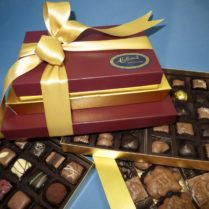 crimson and gold gift tower of gourmet chocolates
