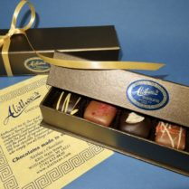 bronze tone box of gourmet chocolate truffles