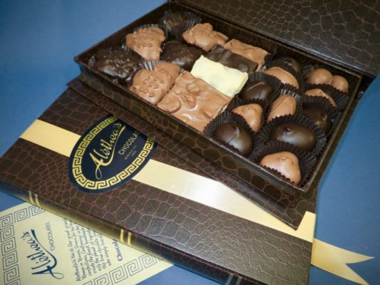 handsome book box filled with gourmet chocolates