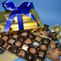 Fabulous array of gourmet chocolate in a gold gift tower