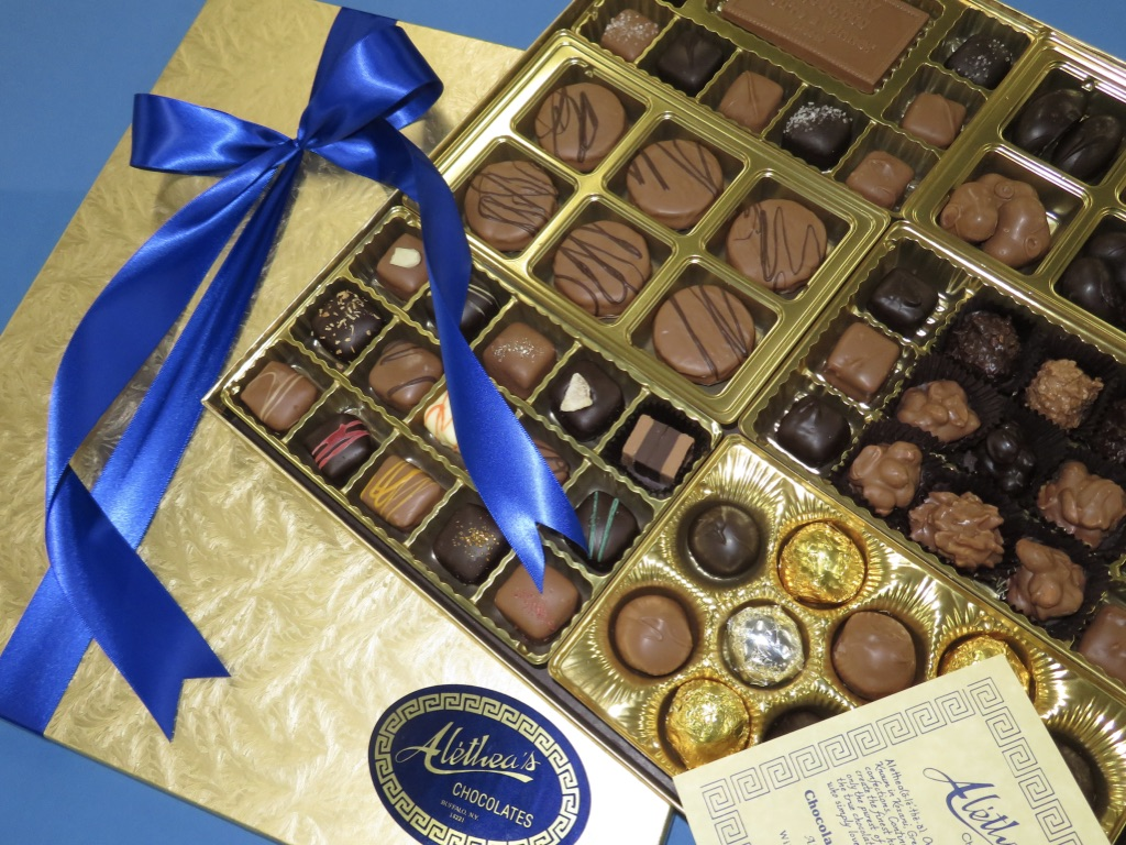 grand display of gourmet chocolates in a gold gift box