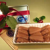 Holiday gift tin of gourmet chocolate covered butter cookies