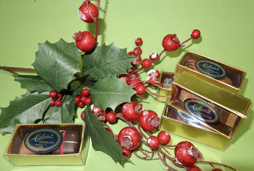 gold truffle boxes with Holly berries