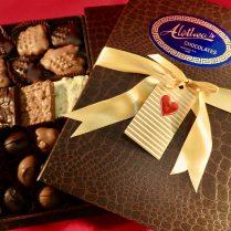 Valentine decorated book box full of gourmet chocolates